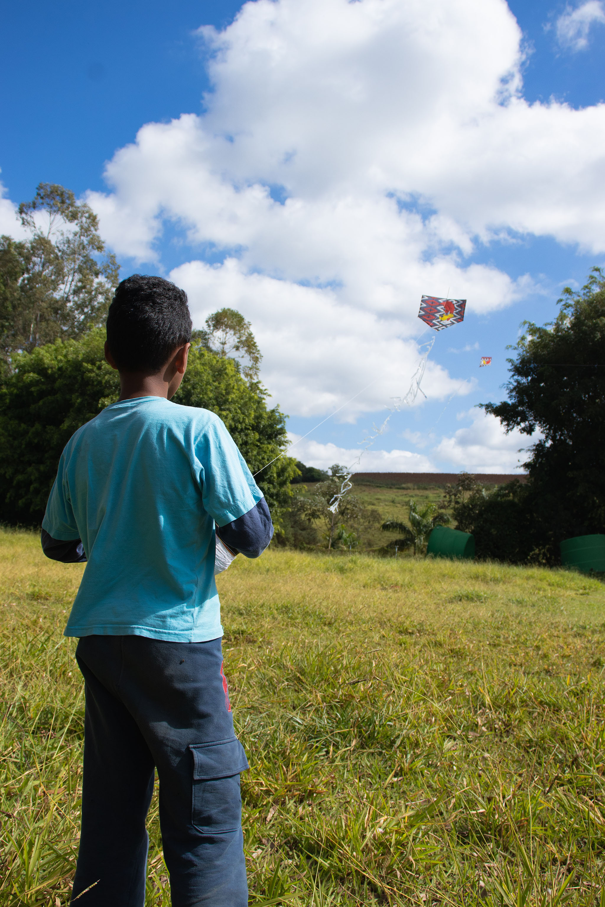 One of the boys flying a homemade kite
